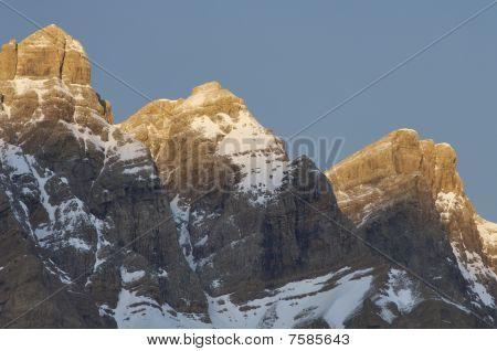 Three Snow-capped Peaks