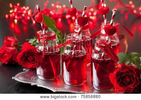 Valentine's Day party idea:individual small bottles with cranberry cocktail