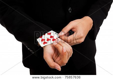 Cheating Asian Businessman Pull Playing Cards From Sleeve