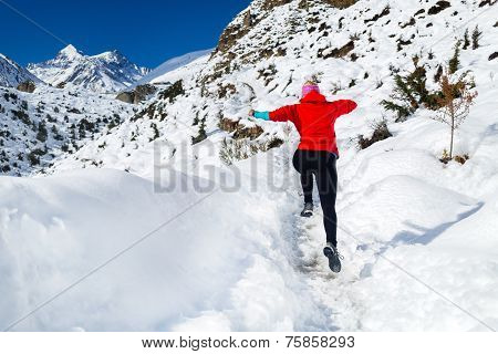 Woman Jumping Running In Winter Mountains