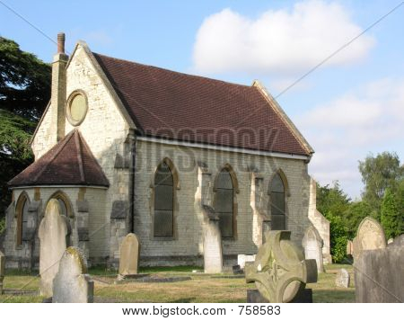 Stone chapel in graveyard