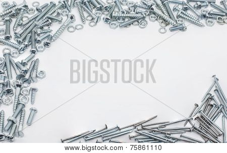 Collection Of Iron Screws, Nuts, Nails And Lockwashers Above And Below