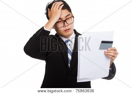Asian Businessman Headache With A Credit Card And  Statement