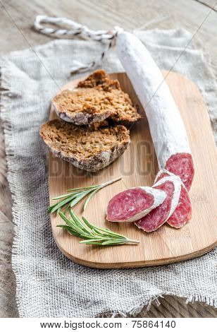 Slices Of Spanish Salami On The Sackcloth
