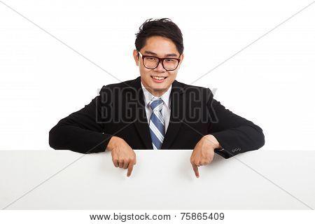 Asian Businessman Point Down Behind Blank Banner