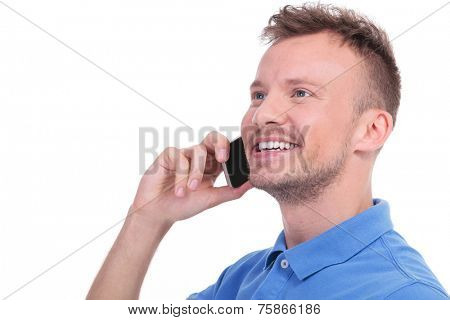 close up picture of a young casual man talking on the phone and smiling while looking away from the camera. isolated on a white background
