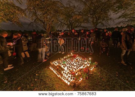 Candels Lit During All Saints Night Or Halloween At The Woodland Cemetary