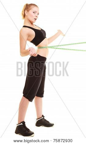 Diet. Slim Blonde Girl With Measure Tape Measuring Waist