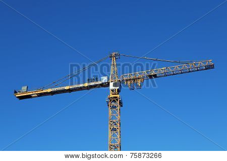 Team Of Installers Stands On Counterweight Jib Yellow Tower Crane.