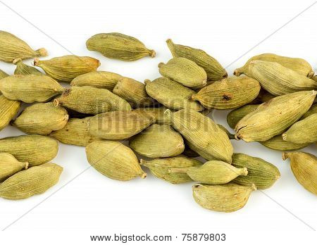 Horizontal Closeup View Of Cardamom Seed Pods Randomly Scattered Isolated On White