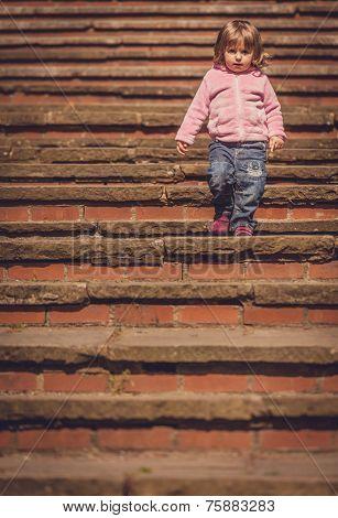 Baby girl walking down
