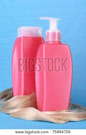 Shampoo and hair conditioner with  curly blond hair on