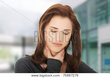 Charming young woman with terrible throat pain