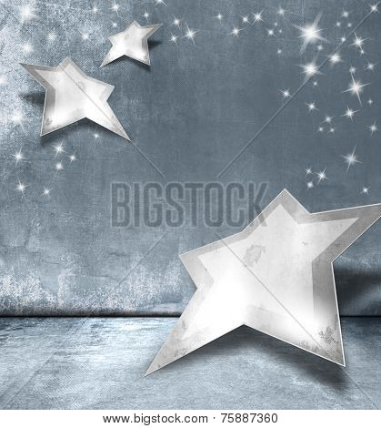 Silver stars against blue gray background - abstract Christmas design with sparkle lights