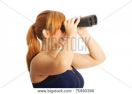 Overweight woman seeking with binocular.