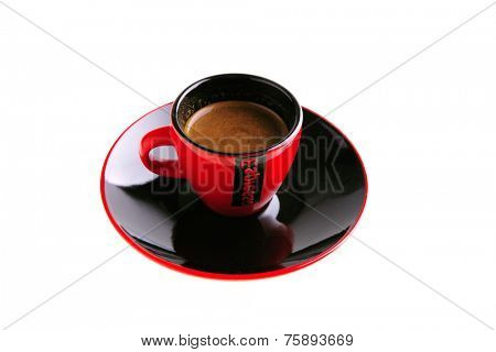 black coffee in red small ceramic cup on white