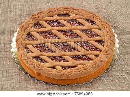 Peach jam cake on rustic fabric.