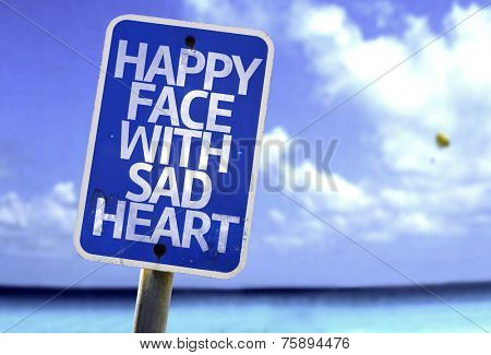 Happy Face With Sad Heart sign with a beach on background
