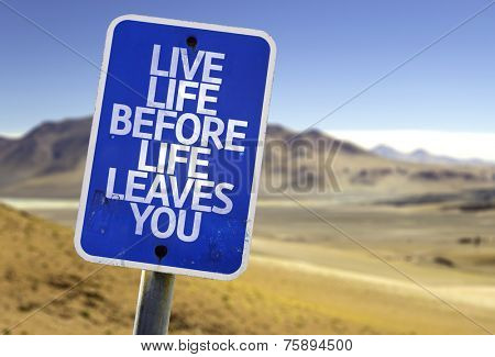 Live Life Before Life Leaves You sign with a desert background