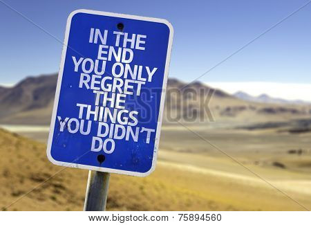 In The End You Only Regret The Things You Didn't Do sign with a desert background