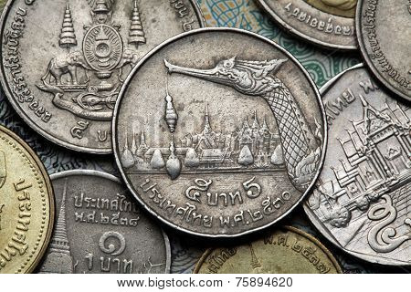 Coins of Thailand. Royal Barge Suphannahong and the Grand Royal Palace in Bangkok depicted in the old Thai five baht coin.