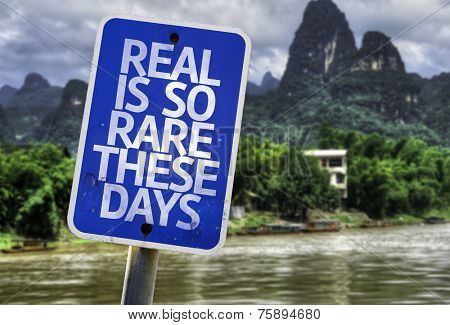 Real is So Rare These Days sign with a exotic background