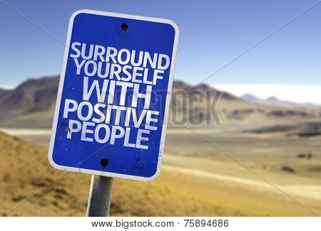 Surround Yourself with Positive People sign with a desert background