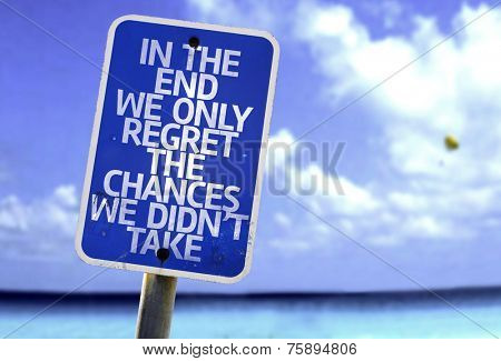 In The End You Only Regret The Things You Didn't Do sign with a beach on background