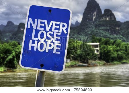 Never Lose Hope sign with a exotic background