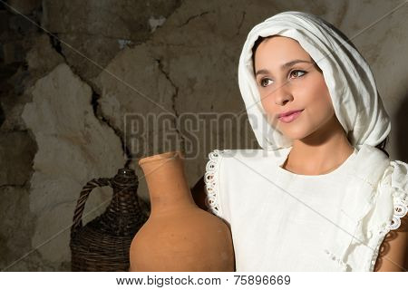 Biblical portrait of a woman depicting mother Mary holding a wine jug