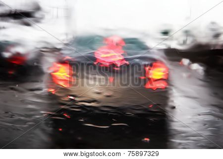 Through a car windshield during rain storm
