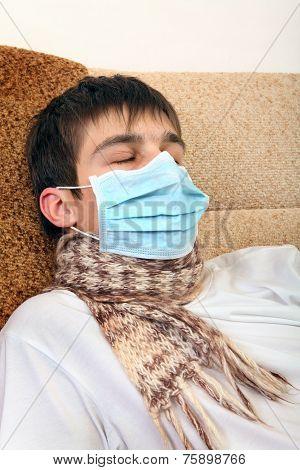 Sick Teenager In Flu Mask