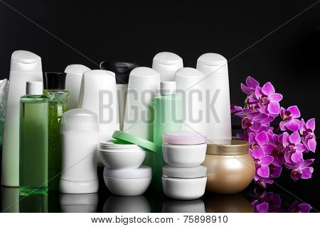 bottles with shampoo on black background