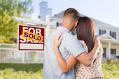 stock photo of nice house  - Sold For Sale Real Estate Sign and Affectionate Military Couple Looking at Nice New House - JPG