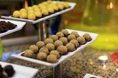 stock photo of cake-ball  - Brown ball cakes on the tray at a buffet - JPG