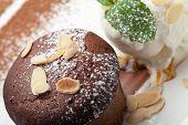 foto of cake-ball  - Warm dessert chocolate cake Fondant served on plate with ice - JPG