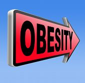 picture of obese  - obesity road sign over weight or obese people suffer eating disorder and can be helped by dieting  - JPG