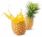 picture of fruit-juice  - pineapple juice splashing out from its fruit - JPG