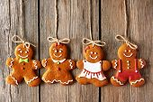 image of christmas cookie  - Christmas homemade gingerbread couple cookies over wooden background - JPG