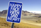 image of loveless  - Happy Face With Sad Heart sign with a desert background - JPG