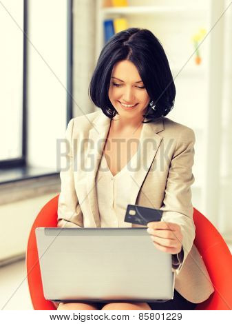 picture of happy woman with laptop computer and credit card
