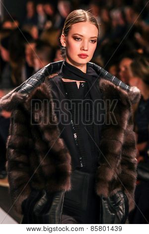 NEW YORK - FEBRUARY 16: A model walks the runway at the Dennis Basso Fall/Winter 2015 collection during Mercedes-Benz Fashion Week in New York on February 16, 2015.