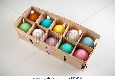 Easter Colored Eggs In Wooden Box Isolated