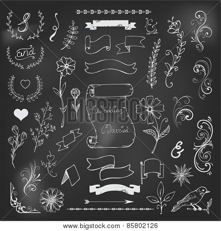 Catchwords, ribbons, ampersands design elements set on black board