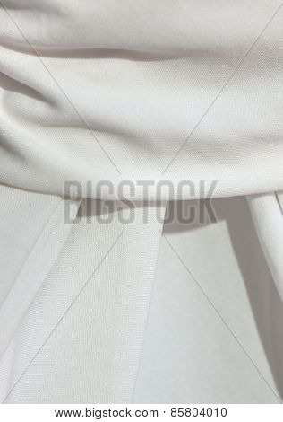 Detail of a draped white table cloth