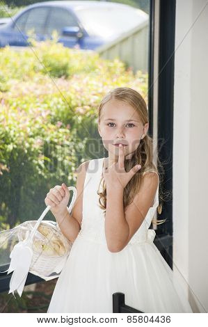 Cute Blonde Flower Girl With Basket In White Dress