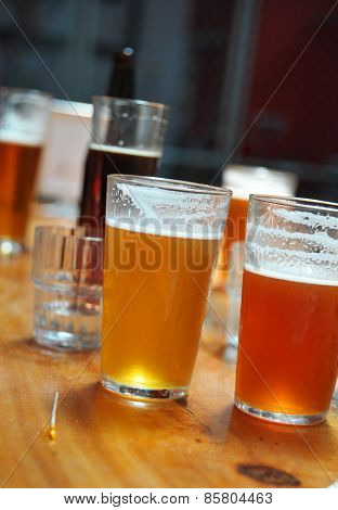 Variety Of Different Beers, Of Different Colors And Alcoholic Strengths In Different Shaped Glasses
