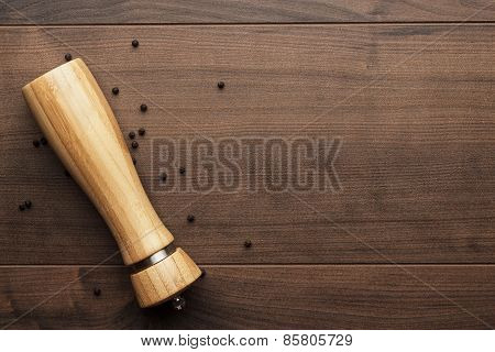 wooden pepper mill on the table