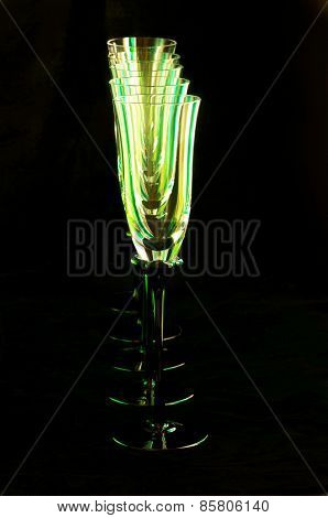 Flute Glasses In A Column Against Black