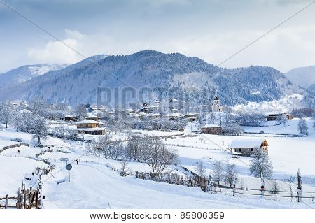 Village with towers in the Valley of Caucasus Mountains